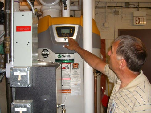 Randy Washburn shows off Itasca county's new energy management controls