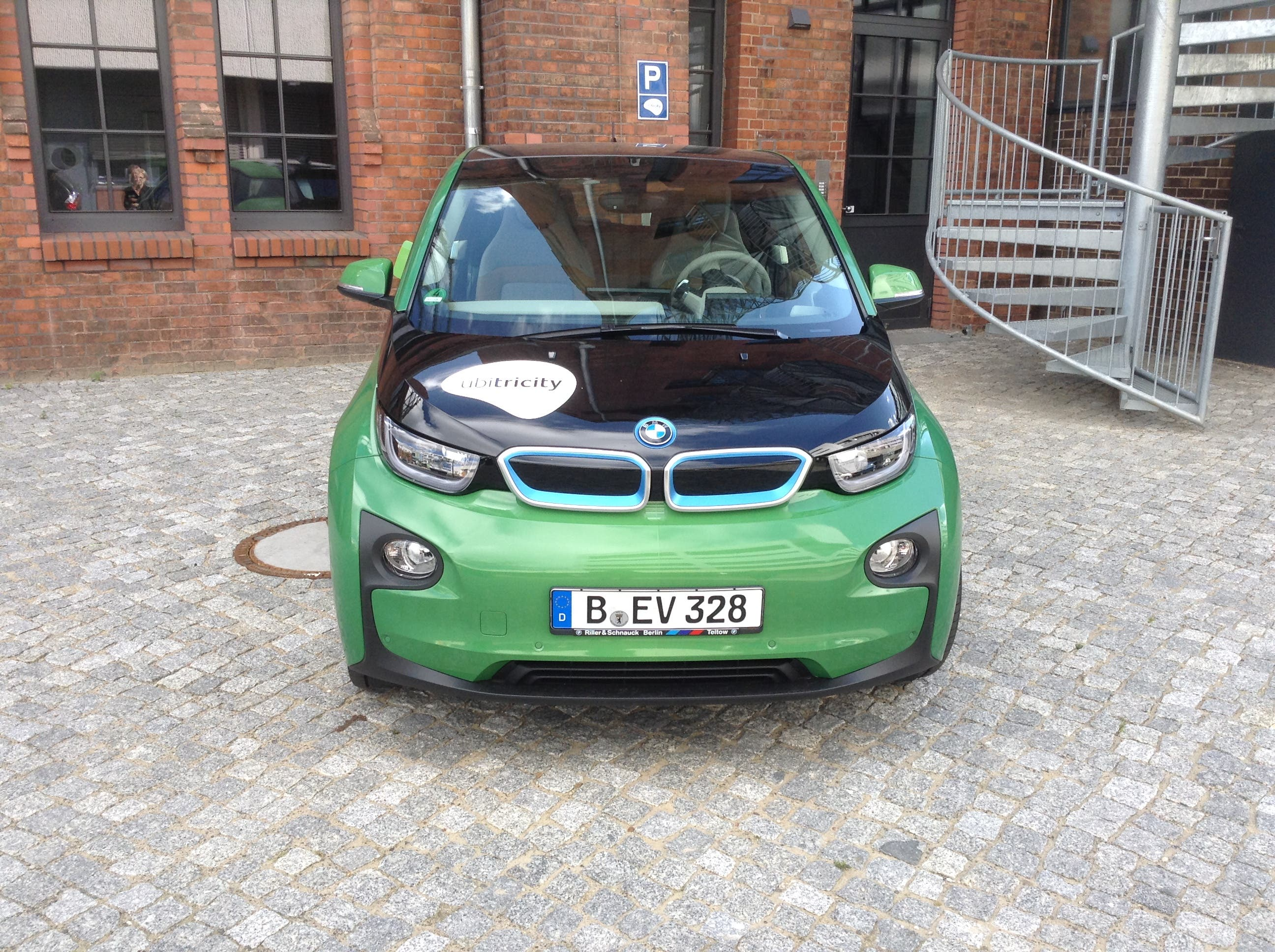 A ubitricity BMW i3 electric car charging in Berlin, Germany.