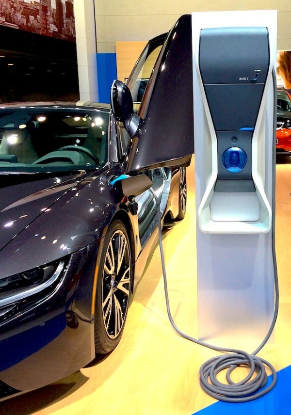 BMW i8 EV with charging station