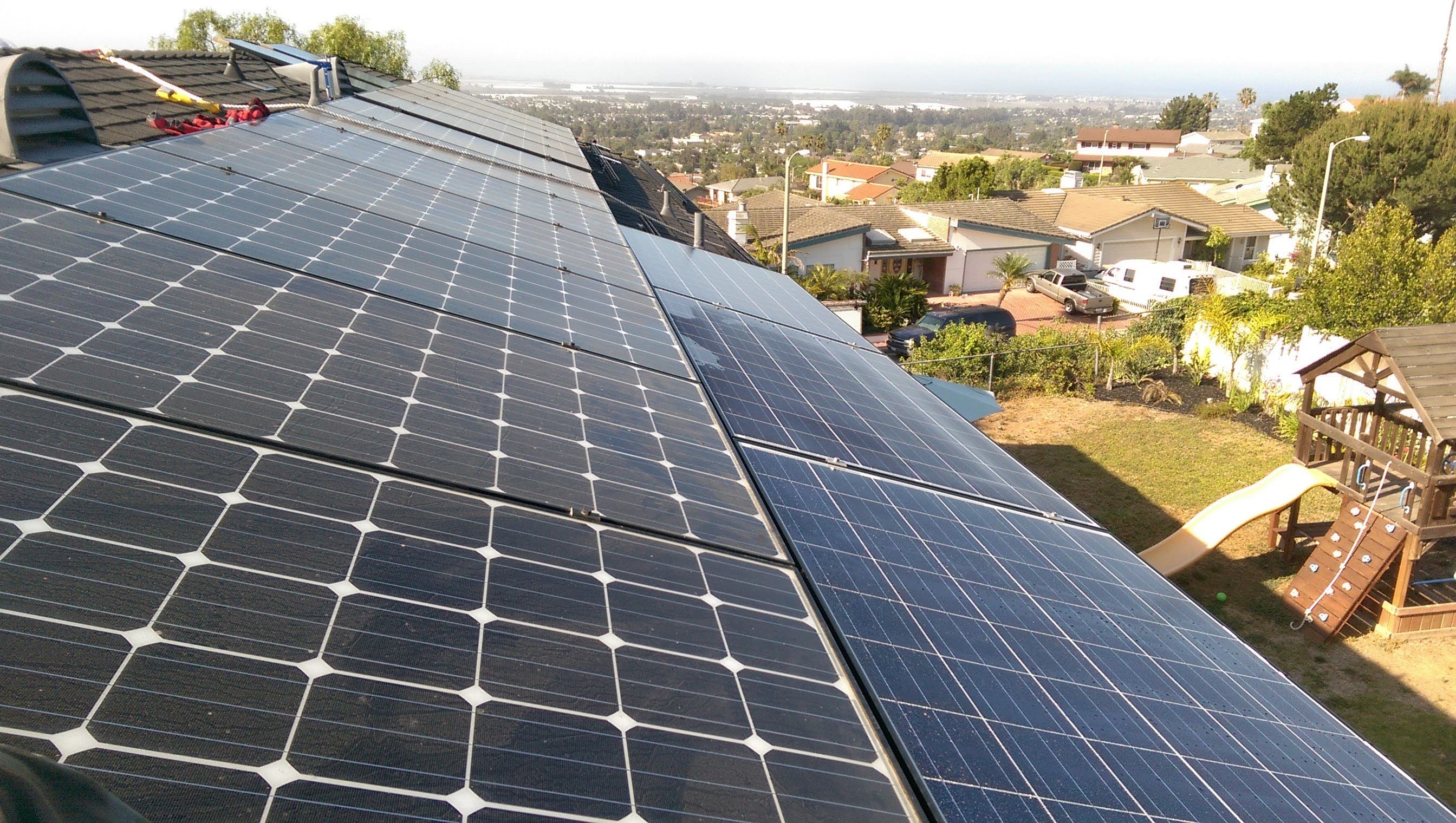 REC Solar and Sunrun solar rooftop system on California home.