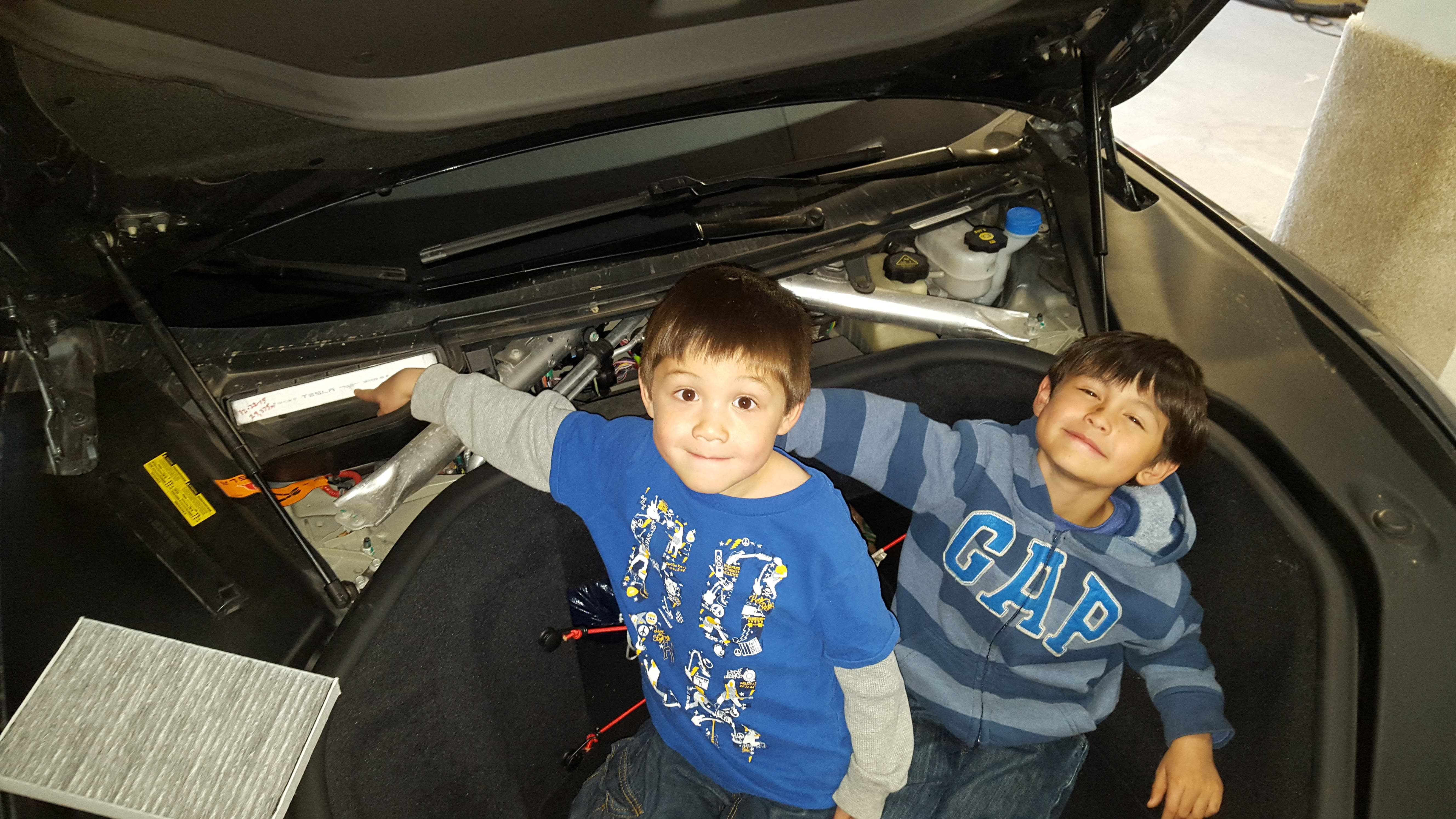 The Little Dudes Helping Swap Out Cabin Air Filter On My Model S