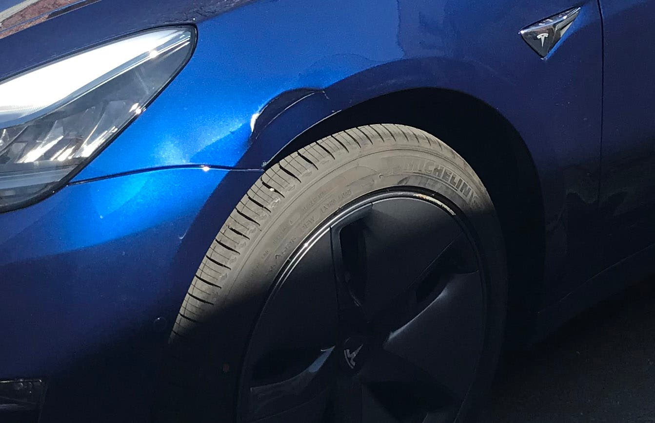 Tesla Model 3 damaged fender
