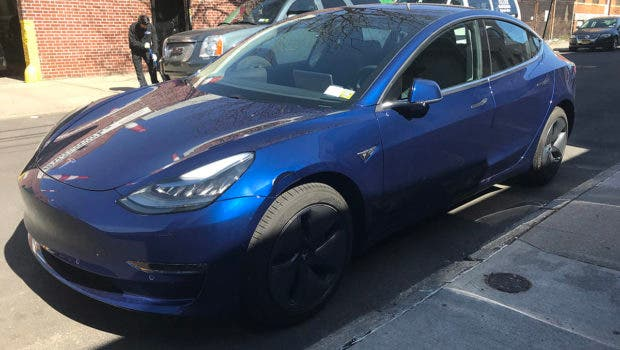 Tesla Model 3 with fender dent.