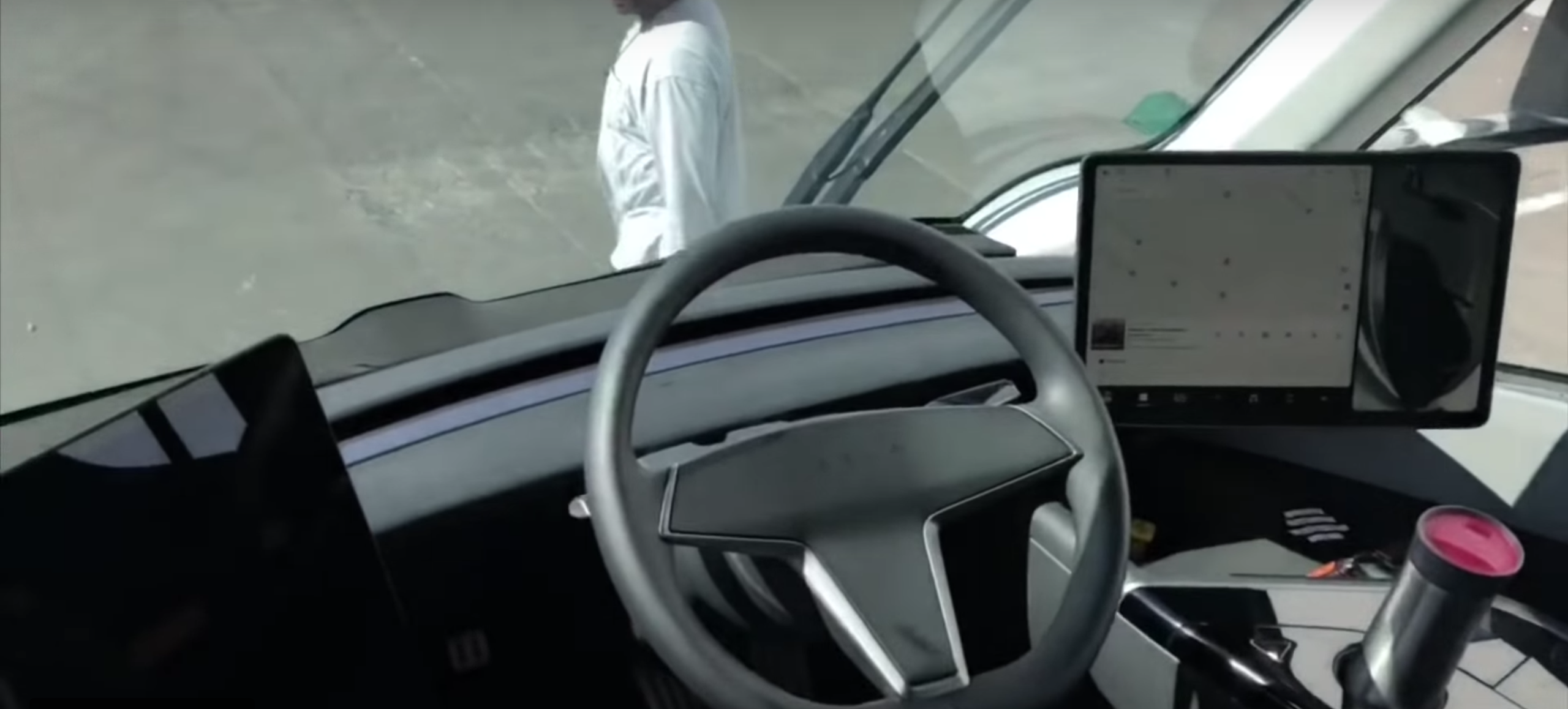 Putting The Monitors Off To Side Keeps Sightline Out Front Of Vehicle As Clear Possible While Giving Tesla Design Flexibility With