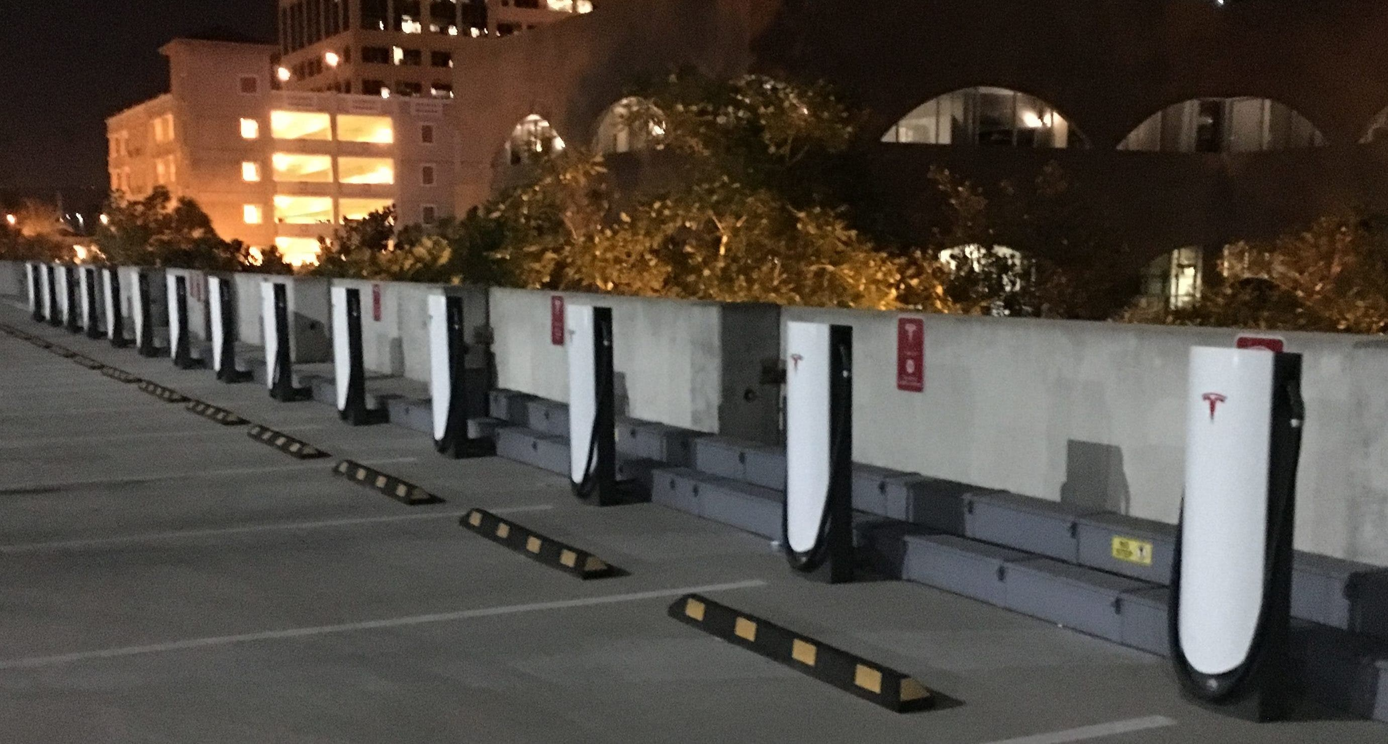 Riverside Tesla Supercharger - rooftop parking empty urban superchargers