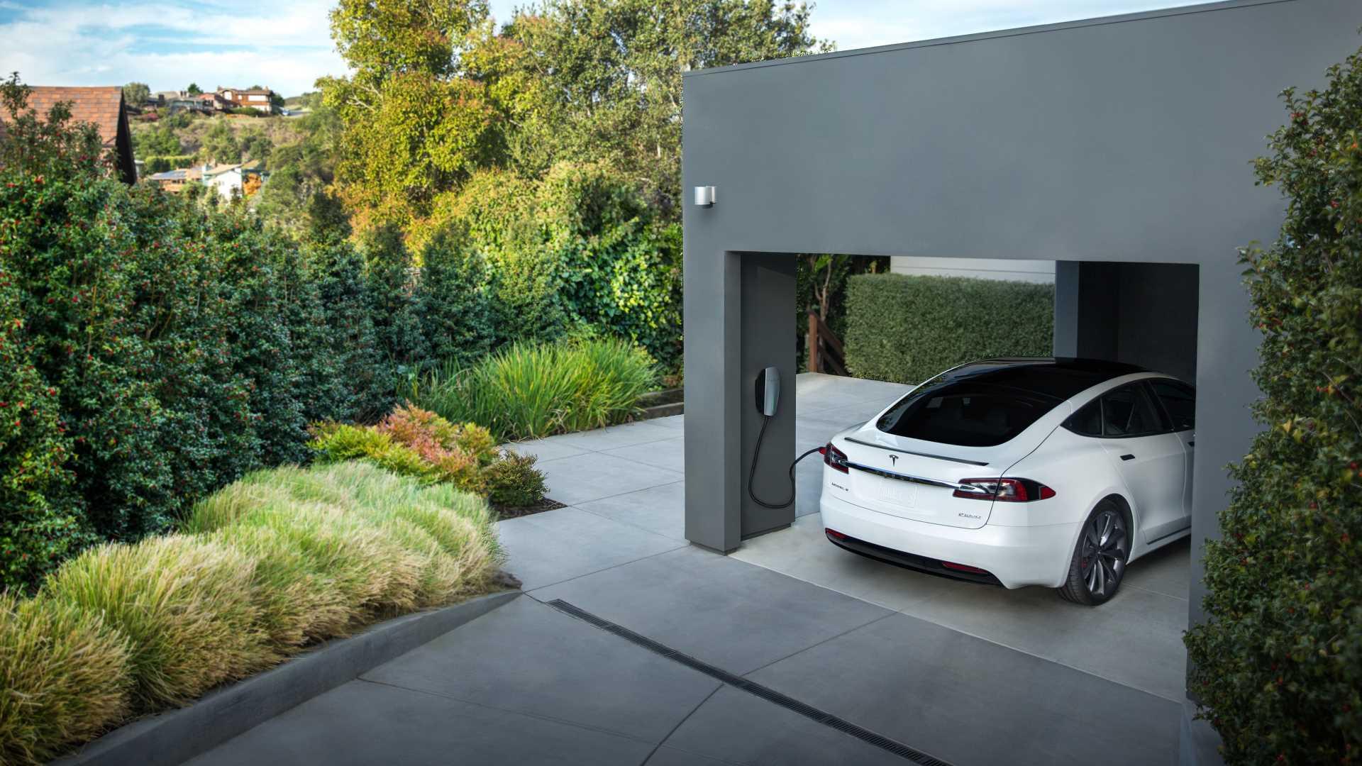 A Tesla charging at home