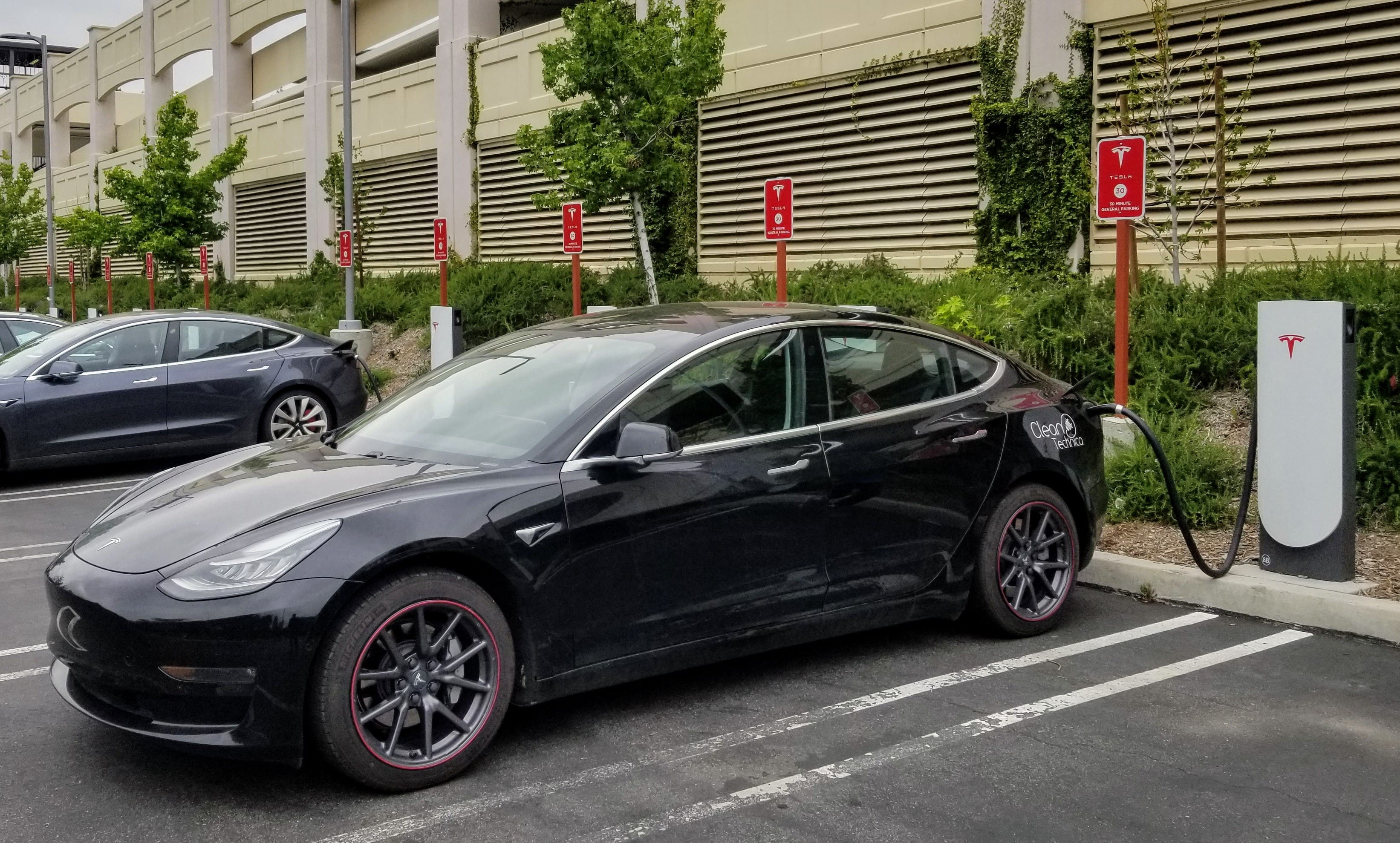 Tesla Model 3 at one of Tesla's Urban Superchargers