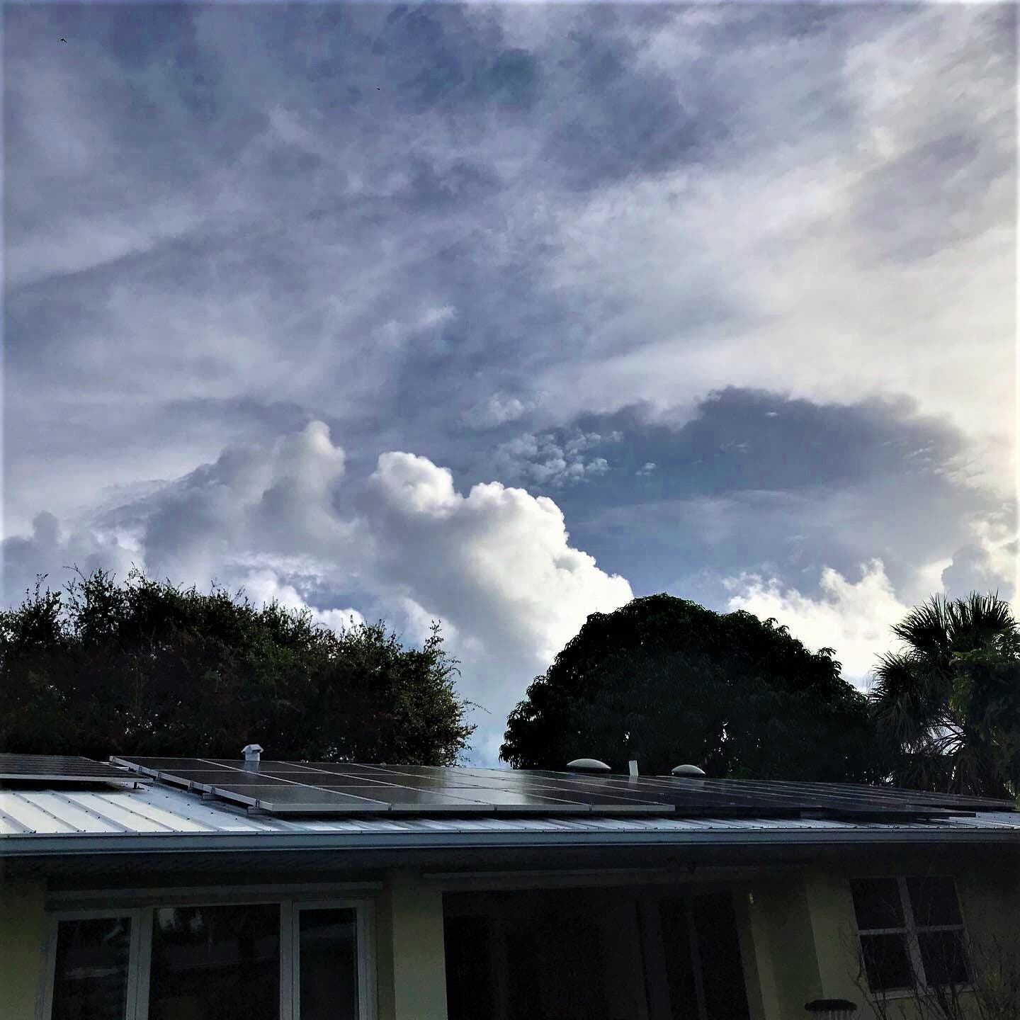 Solar home in Cocoa Beach: Solar hot water, PV pumped pool, and 6 kW PV system.