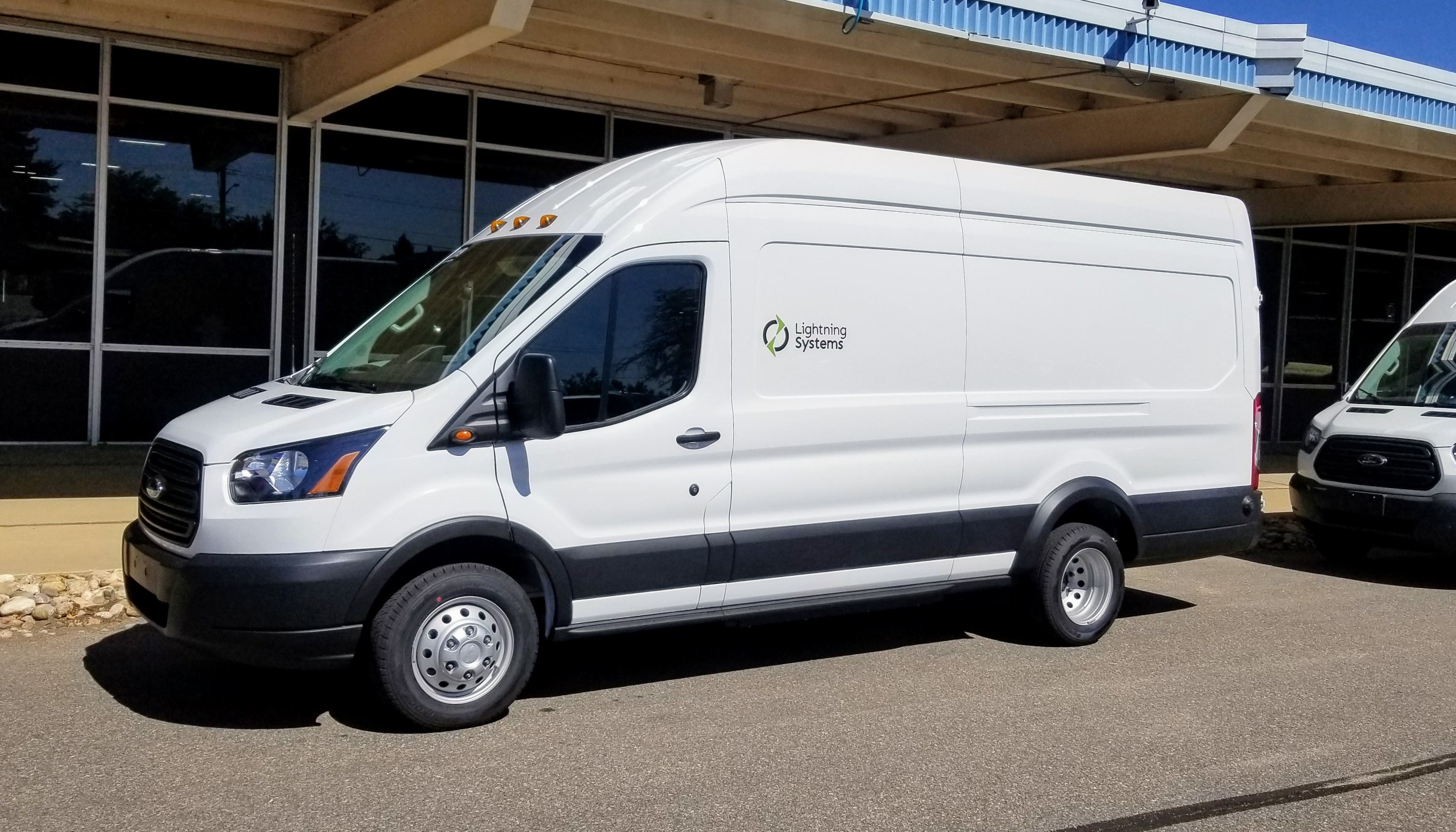 A fully electric Lightning Systems Ford Transit.