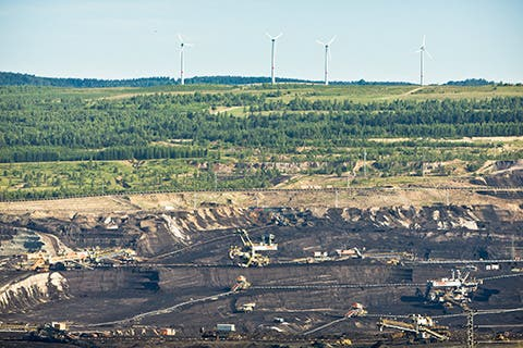 Wind turbines behind an open pit coal mine