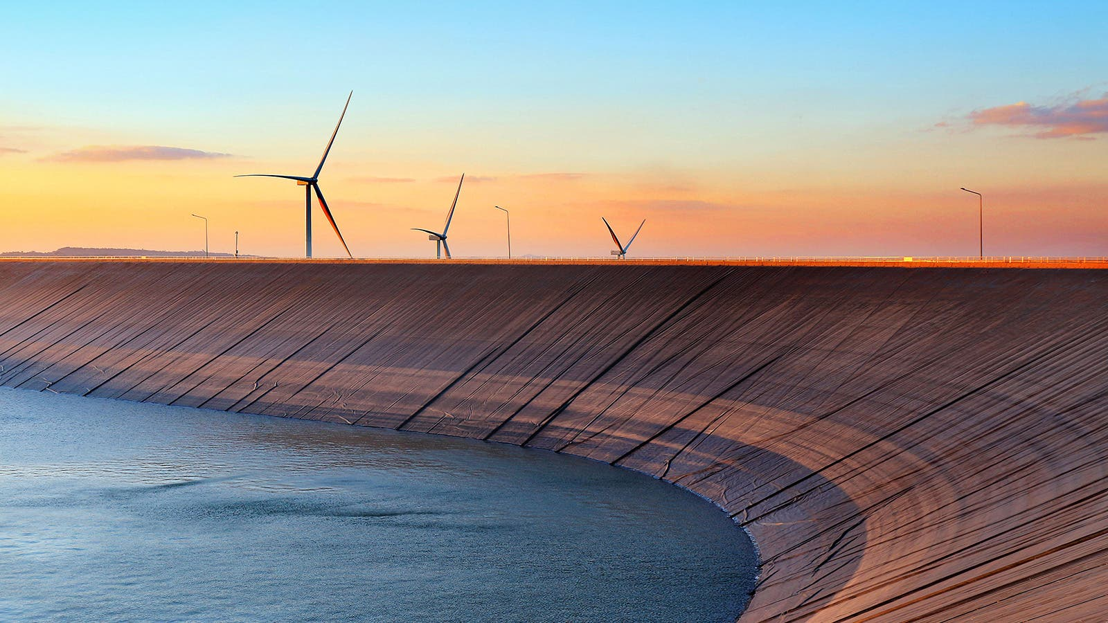 Pumped storage with wind turbines in background