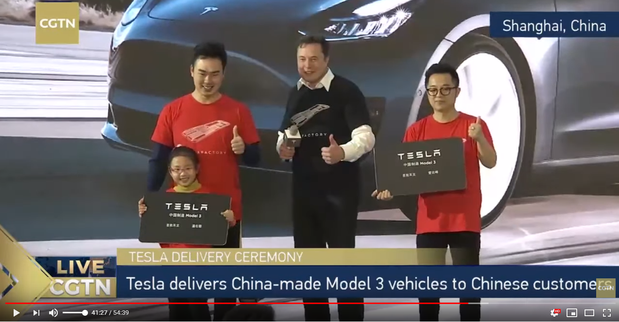 Musk rips off jacket, jives at Tesla's Shanghai plant