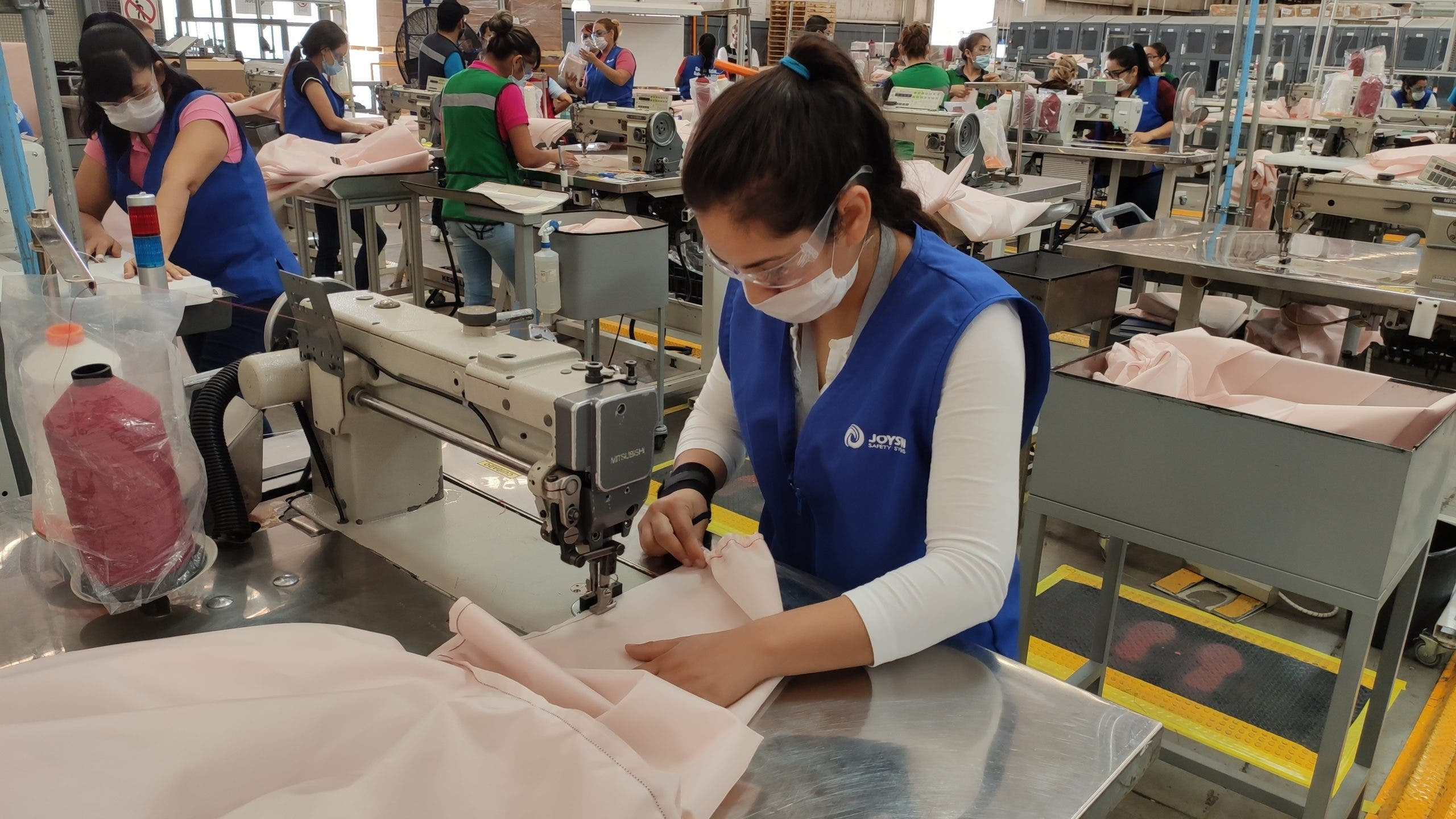 Ford employees making PPE gowns out of airbag nylon