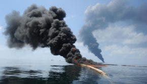 Clouds of smoke and fire emerge during a controlled burn in an effort to clean up oil in the Gulf of Mexico following the Deepwater Horizon explosion. Justin Stumberg/U.S. Navy