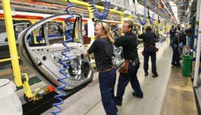 Volvo factory workers assembling doors