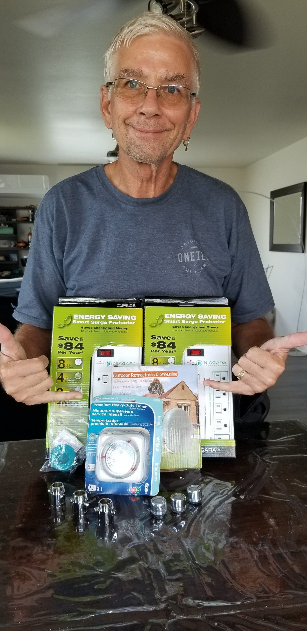 Kauai resident George Evanoff with his box of free home efficiency goodies that specifically match his home's needs.