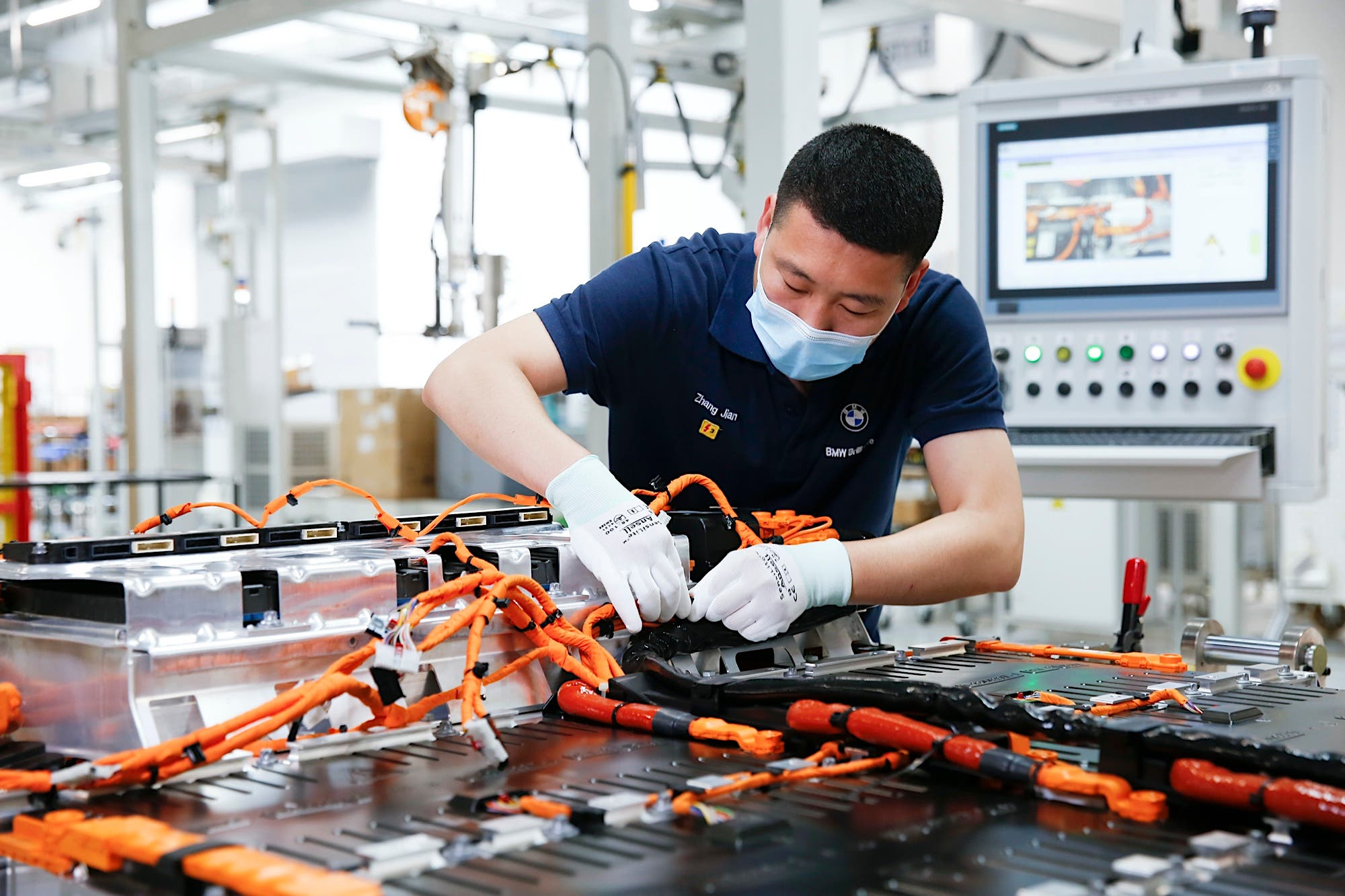 BMW iX3 electric SUV China battery production worker